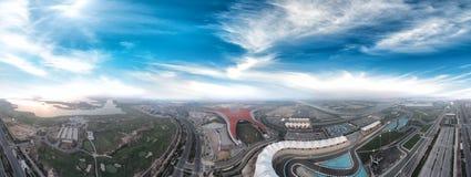 Panoramic aerial view of Abu Dhabi Yas Island sunset skyline royalty free stock images