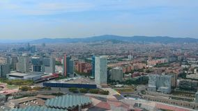Panoramic aerial view of Barcelona. A drone flies over the houses of Barcelona. Panoramic view of Barcelona from the drone. A drone flies over the houses of stock video