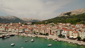 Panoramic aerial view of Baska town, popular touristic destination on island Krk Croatia Europe stock video footage