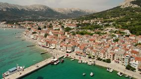 Panoramic aerial view of Baska town, popular touristic destination on island Krk Croatia Europe stock video