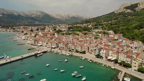 Panoramic aerial view of Baska town, popular touristic destination on island Krk Croatia Europe.  stock footage