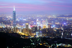Panoramic aerial view of busy Taipei City, Taipei 101, Tamsui River and downtown area at dusk Stock Photos