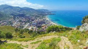 Panoramic aerial view of Cefalu city, Sicily, Italy. People hike on hillside of Rocca di Cefalu, Sicily, Italy. Cefalu is one of the major tourist attractions in stock video
