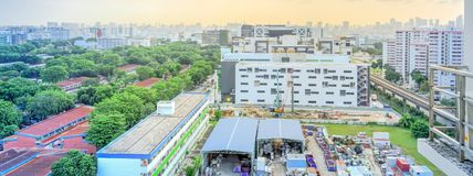 Panoramic aerial view construction site foundation works at Eunos neighborhood, Singapore. Panorama aerial view construction site near completed HDB complex at stock photography