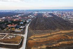 Panoramic aerial view of the cottage settlement by sea. Top view of the marine cottage village, line of strengthening the coast in. Zone of landslide. Villa on stock photos