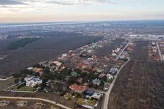 Panoramic aerial view of the cottage settlement by sea. Top view of the marine cottage village, line of strengthening the coast in. Zone of landslide. Villa on stock images