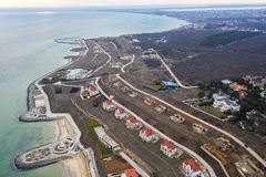 Panoramic aerial view of the cottage settlement by sea. Top view of the marine cottage village, line of strengthening the coast in. Zone of landslide. Villa on stock image