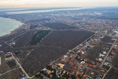 Panoramic aerial view of the cottage settlement by sea. Top view of the marine cottage village, line of strengthening the coast in. Zone of landslide. Villa on royalty free stock photo