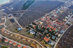 Panoramic aerial view of the cottage settlement by sea. Top view of the marine cottage village, line of strengthening the coast in. Zone of landslide. Villa on royalty free stock photos