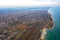 Panoramic aerial view of the cottage settlement by sea. Top view of the marine cottage village, line of strengthening the coast in. Zone of landslide. Villa on royalty free stock images