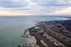 Panoramic aerial view of the cottage settlement by sea. Top view of the marine cottage village, line of strengthening the coast in. Zone of landslide. Villa on stock photo