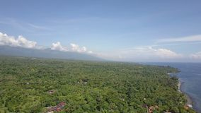 Panoramic aerial view from drone on sea, seashore, jungle and mountains, Bali, Indonesia stock video