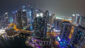 Aerial view of Dubai Marina residential and office skyscrapers with waterfront night timelapse. Panoramic aerial view of Dubai Marina residential and office stock video