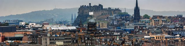 Panoramic aerial view of Edinburgh, Scotland in moody weather. Edinburgh, UK. Panoramic aerial view of Edinburgh, Scotland in moody weather with castle and royalty free stock photos