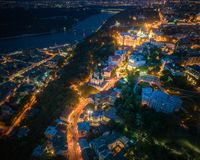 Evening Kiev, Ukraine. Aerial view. Panoramic aerial view of evening Kiev above Andrews Descent and St. Andrews Church with the Dnieper River in the background royalty free stock photography