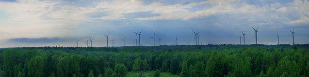 Panoramic and aerial view of a farm of wind turbines Royalty Free Stock Photos
