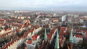Panoramic aerial view of Gdansk old town, Poland. View from St. Mary`s Church Basilica of the Assumption of the Blessed Virgin Mary. Foggy winter morning stock footage