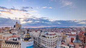 Panoramic aerial view of Gran Via timelapse at sunset, Skyline Old Town Cityscape, Metropolis Building, capital of Spain