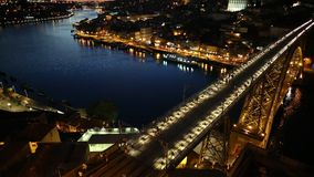 Porto sunset skyline. Panoramic aerial view of iron arch bridge Dom Luis I on Douro River at sunset twilight in Porto, Portugal`s second largest city. Urban stock video