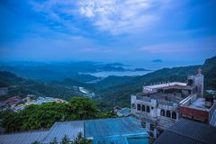 Jiufen. Panoramic aerial View of Jiufen with Keelung port and Sea from jiufen old street royalty free stock image