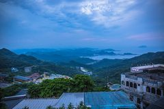 Jiufen. Panoramic aerial View of Jiufen with Keelung port and Sea from jiufen old street royalty free stock photo
