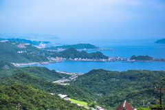 Jiufen. Panoramic aerial View of Jiufen with Keelung port and Sea from jiufen old street stock photography