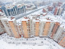 Panoramic aerial view at the long residential building with inner yard with parked cars at winter season. St.Petersburg, Russia. Royalty Free Stock Photos