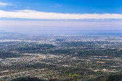 Panoramic aerial view of Los Angeles downtown and the metropolitan area surrounding it; Pasadena in the foreground; Santa Monica royalty free stock image