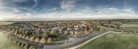 Panoramic Aerial View of Newmarket. A stunning wide panorama of the home of Horse Racing, the town of Newmarket in Suffolk. It is photogaphed from the racecourse stock photo