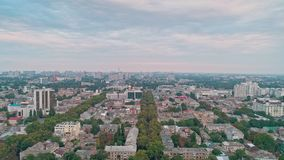 Panoramic aerial view of Odessa city center revealing green trees on a streets and roofs. Against cloudy sky stock video