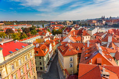 Panoramic Aerial view of old narrow streets in Prague city with Stock Image