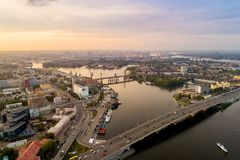 Panoramic aerial view of the old part of the city - Podol district. View of the Rybalsky Island at sunset. Stock Photos