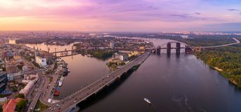 Panoramic aerial view of the old part of the city - Podol district. View of the Rybalsky Island at sunset. Stock Photography