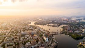 Panoramic aerial view of the old part of the city - Podol district. View of the Rybalsky Island at sunset. Stock Image