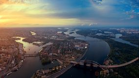 Panoramic aerial view of the old part of the city - Podol district. View of the Rybalsky Island at sunset. Stock Photo