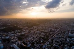 Panoramic aerial view of the old part of the Kiev city - Podol district at sunset. Stock Photo