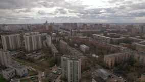 Panoramic aerial view of one of the districts of Moscow, cloudy weather. Urban cityscape from quadrocopter stock video footage