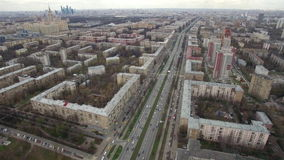 Panoramic aerial view of one of the districts of Moscow, road traffic, cloudy weather. Urban cityscape from quadrocopter. Panoramic aerial view of one of the stock footage
