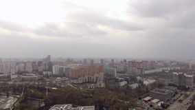 Panoramic aerial view of one of the districts of Moscow with road traffic, cloudy weather. Urban cityscape stock footage