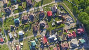Panoramic Aerial view over on residential houses in the countryside, yards and suburban communities in residential. Neighborhoods, street stock footage