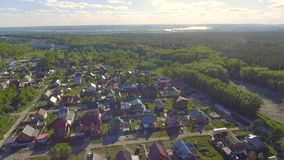 Panoramic Aerial view over on residential houses in the countryside, yards and suburban communities in residential. Neighborhoods, street stock video