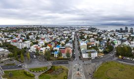 Panoramic aerial view of Reykjavik city, Iceland. Picturesque panoramic aerial view of Reykjavik city, Iceland. Downtown, central street, skyline mountains and Royalty Free Stock Images
