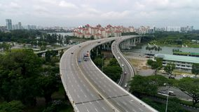 Panoramic aerial view of river bridge in the city with trees in parks. Shot. Aearial view of the bridge with cars stock video footage