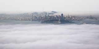 Panoramic Aerial View of San Francisco Bay Area from Grizzly Peak Summit in Berkeley. Fog and clouds rolling through the valley. City, urban skyline royalty free stock photos