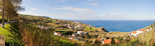 Panoramic aerial view to town over ocean Royalty Free Stock Images