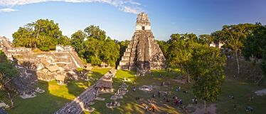Tourists in Tikal Ruins Guatemala Grand Plaza Unesco World Heritage Site. Panoramic Aerial View of Tourists Visiting Grand Plaza in Magnificent Tikal Mayan Ruins royalty free stock photography