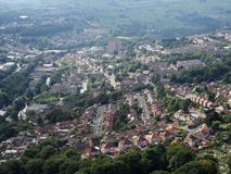 Panoramic aerial view of the town of halifax in west yorkshire with roads streets houses and surrounding pennine landscape. And forests royalty free stock images