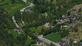 Andorra from above. Smooth camera movement: Tilt up. Panoramic aerial view of the  valley bottom of `Ordino` with green meadows, small villages stock video footage
