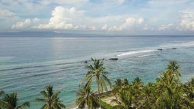 Panoramic aerial view from drone on sea, seashore, jungle and mountains, Bali, Indonesia stock footage