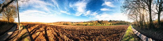 Panoramic agricultural landscape with ploughed field. Nature bac. Panoramic agricultural landscape with ploughed field. Country nature background Royalty Free Stock Image